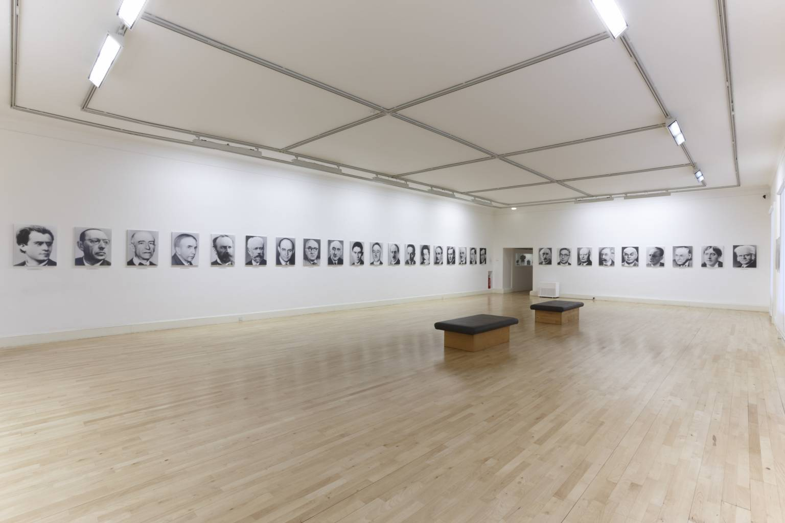 Installation view of 48 Portraits by Gerhardt Richter