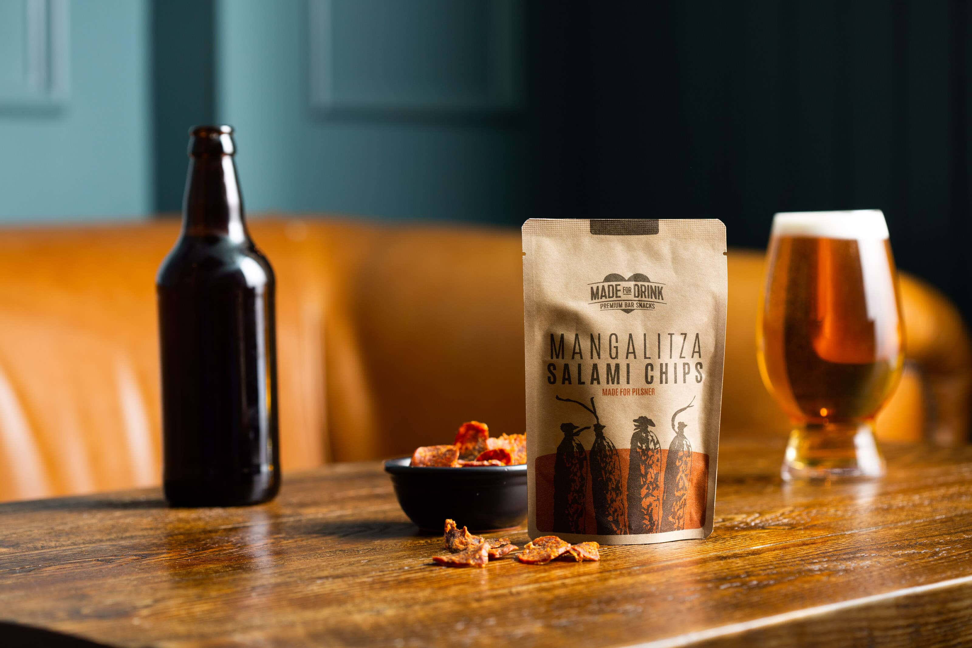 beer and salami snacks on a pub table