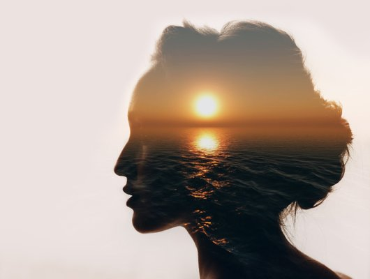sunset in a woman's silhouette