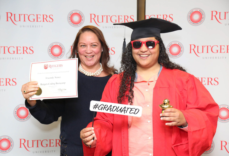 Rutgers boot camp graduate in their cap and gown