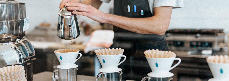 Person preparing coffee