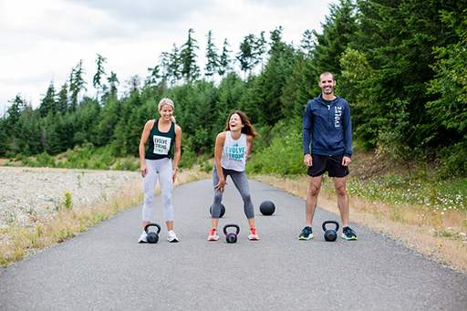 EVOLVE Strong Fitness outdoor workout with kettlebells