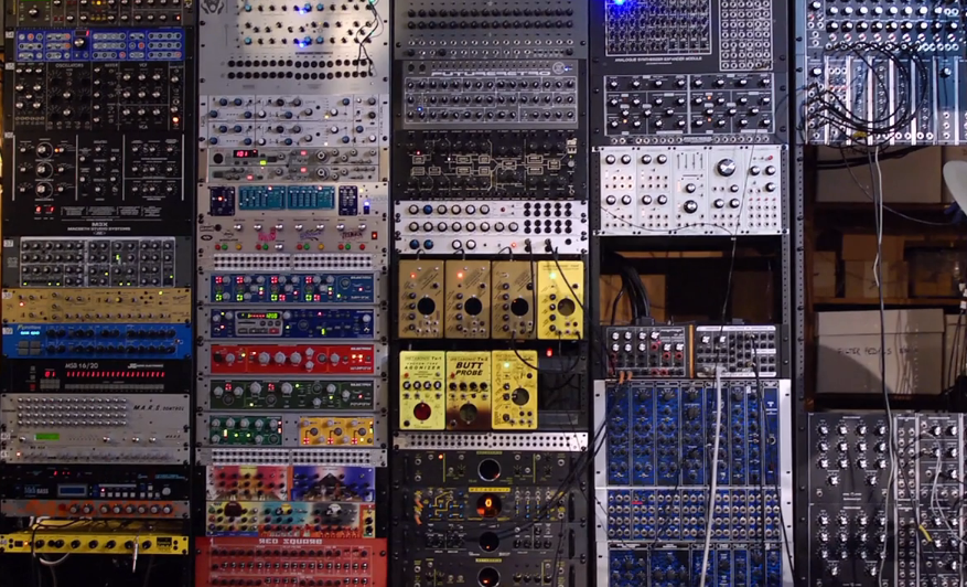 lots of modular synthesizer components connected with wires