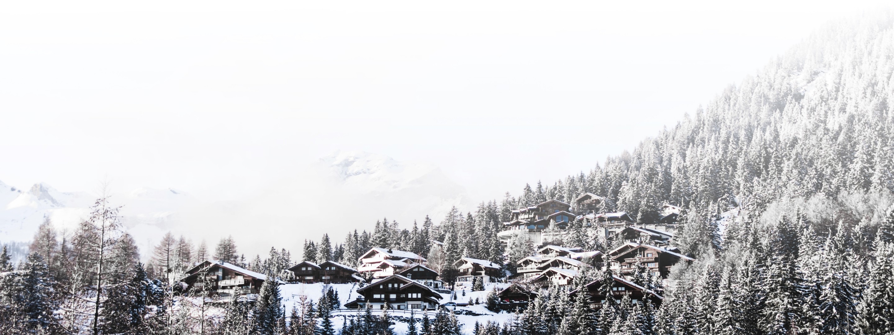Swiss chalets in the snowy alps.