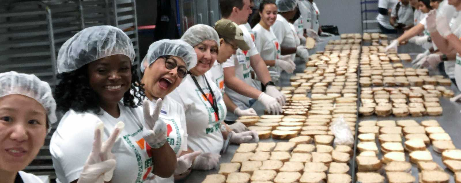 7-Eleven volunteers making sandwiches at hunger busters in Dallas