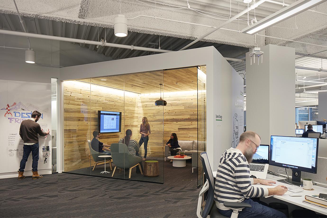 Scene of people working in an office.