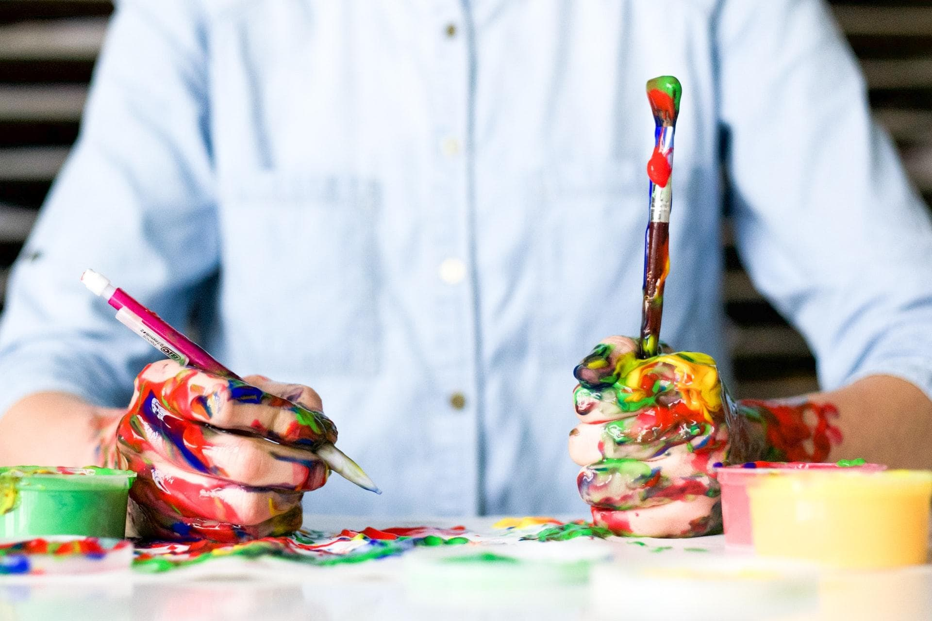 Man holds painted mess