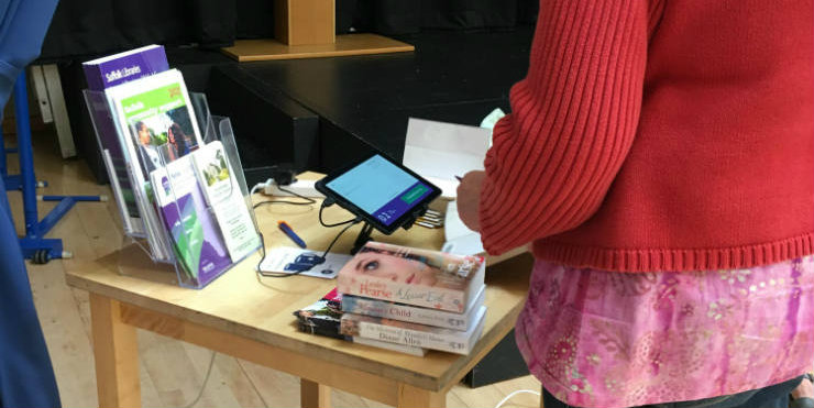 Suffolk Libraries Local customers self-issuing books using a tablet