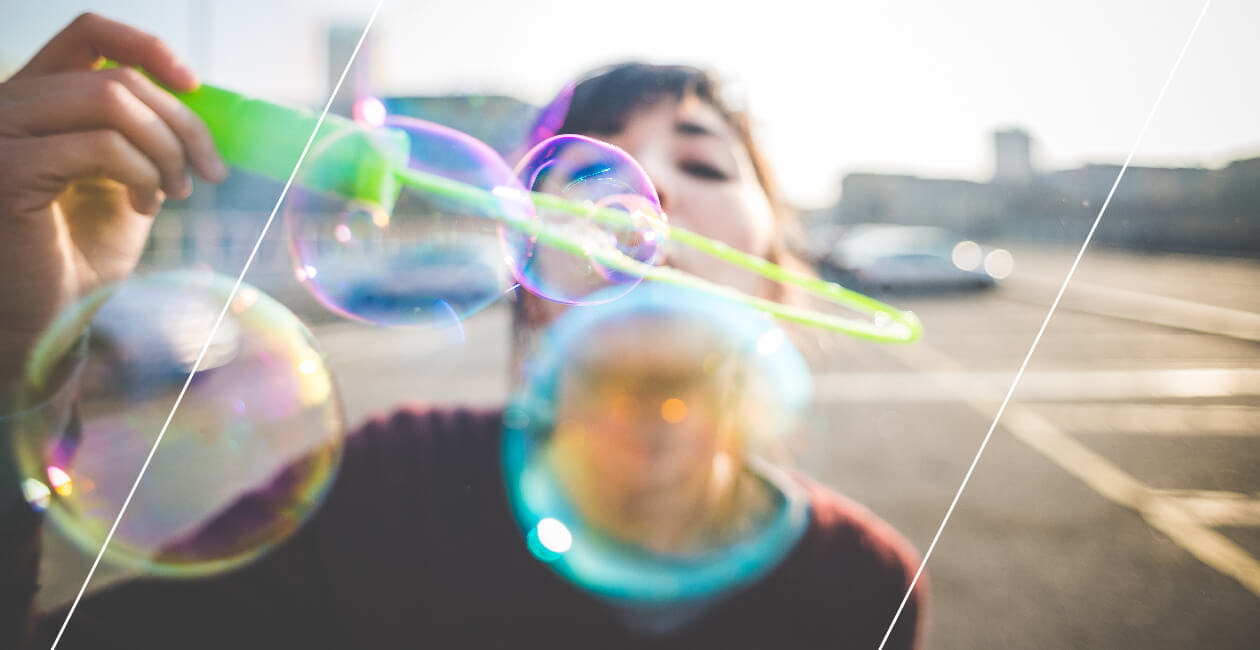 A woman blowing bubbles, symbolizing fun and freedom