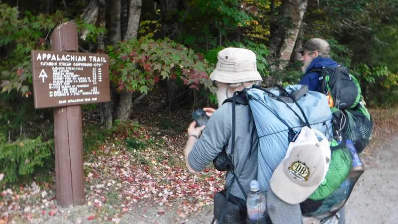 Stick and Tengo read Mt. Katahdin signs