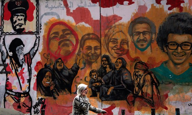 Murals of people killed during Egypt's uprising. Photograph: Amr Dalsh/Reuters