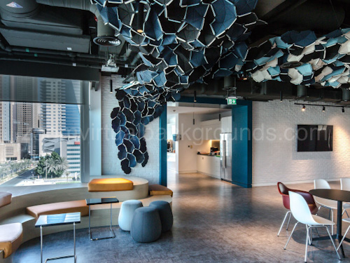 Stylish Workspace Virtual Background for Zoom with casual seating and distinctive angular ceiling design