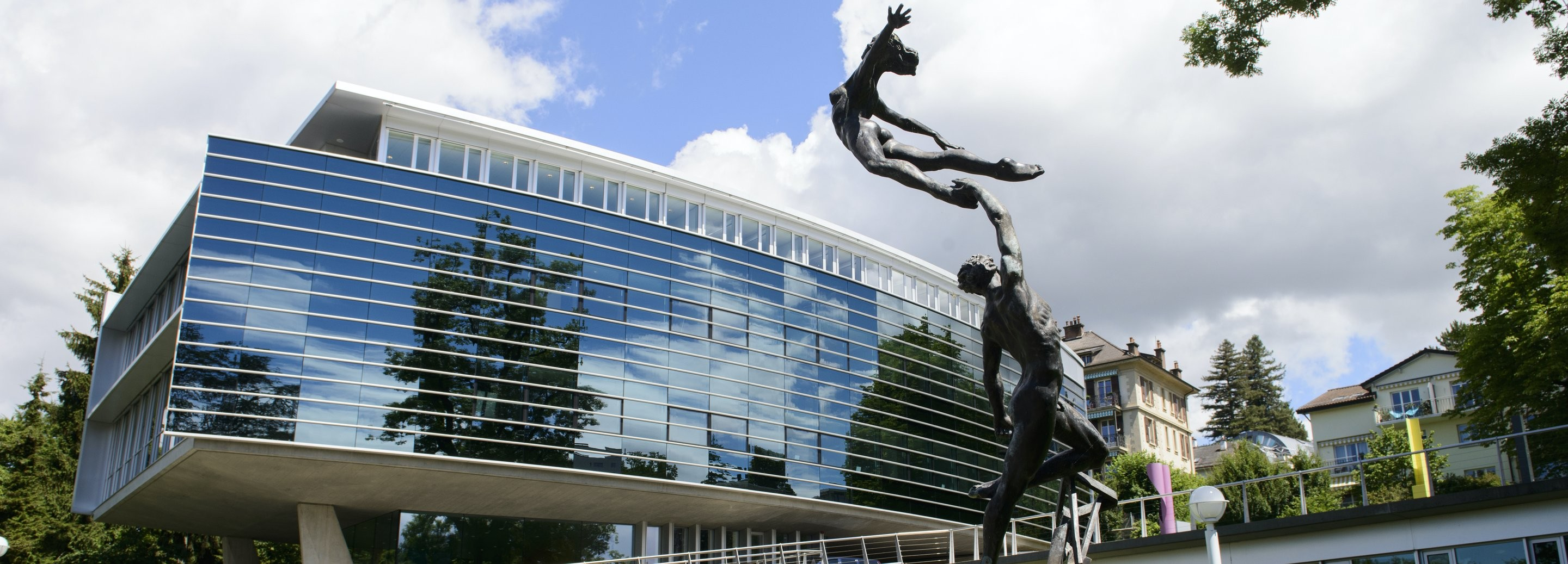 View of a building and statue on the IMD campus