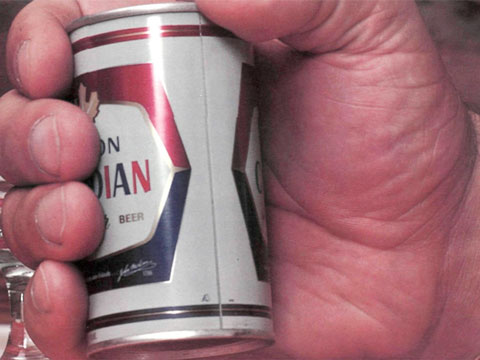 Andre the Giant's massive hands around a can of beer