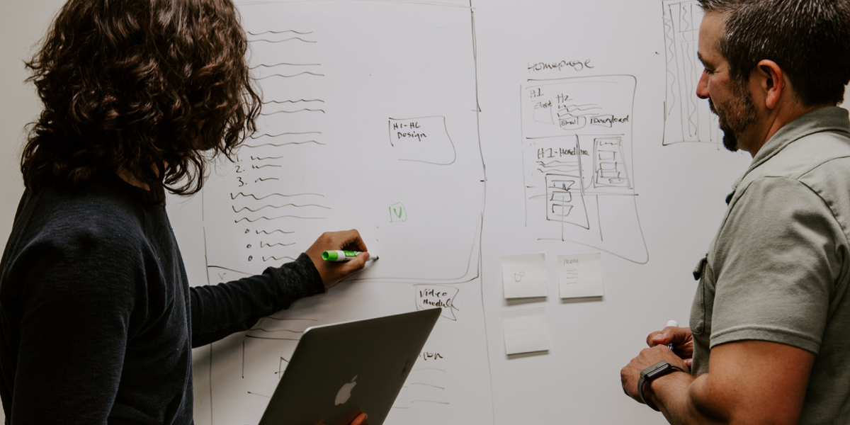 Two UI designers creating a low-fidelity wireframe