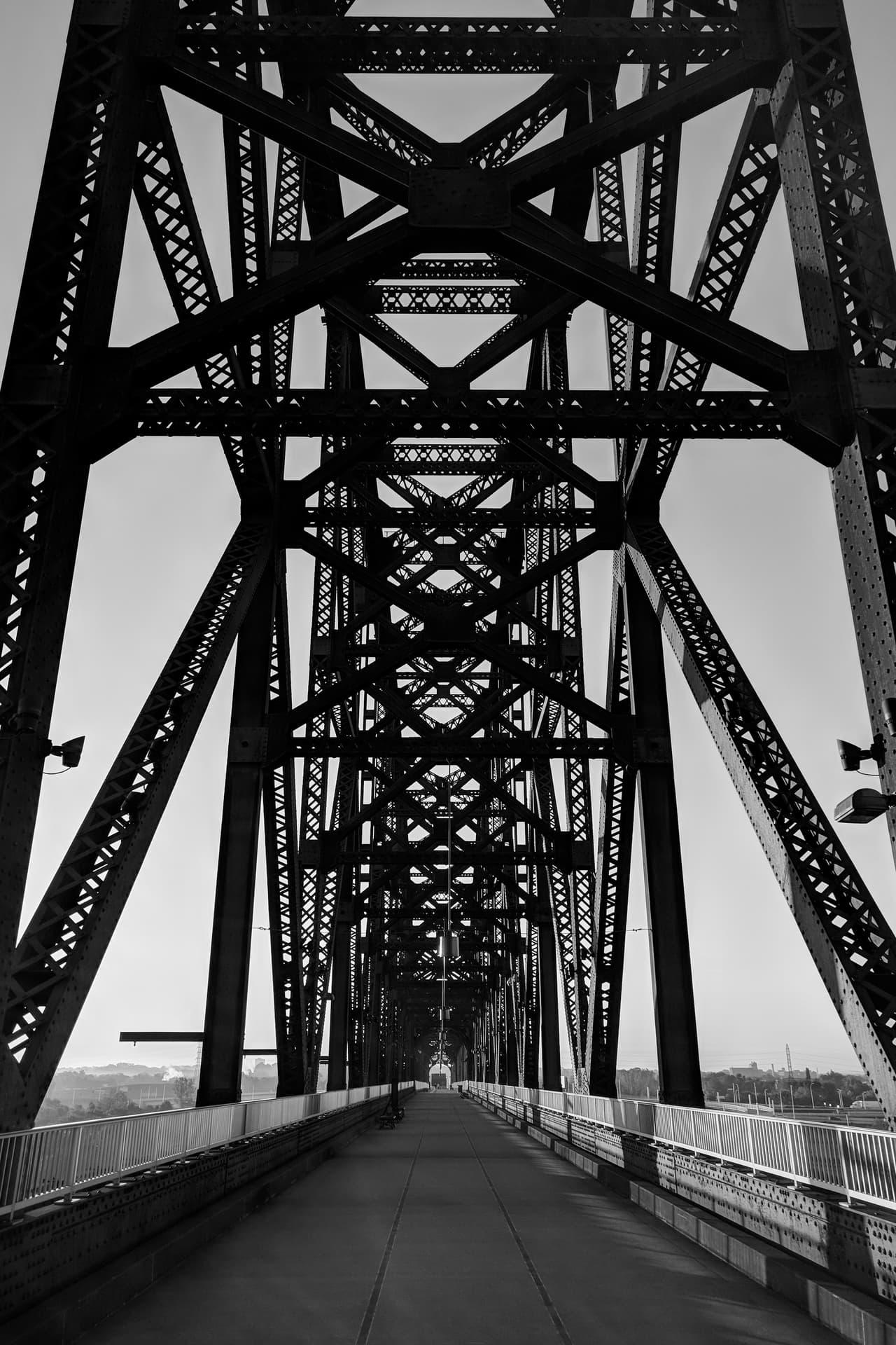 Looking south towards Kentucky along a steel footbridge crossing the Ohio River.