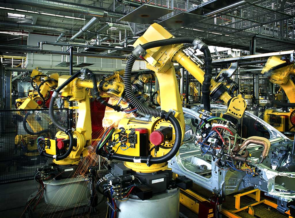 Robots on the factory floor, building a car