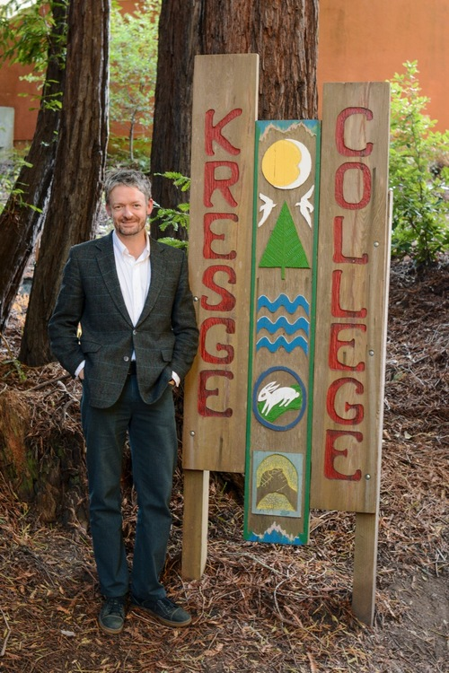 Kresge College provost Ben Leeds Carson stands next the Kresge College sign