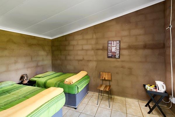 Inside view of two single bed en-suite room.