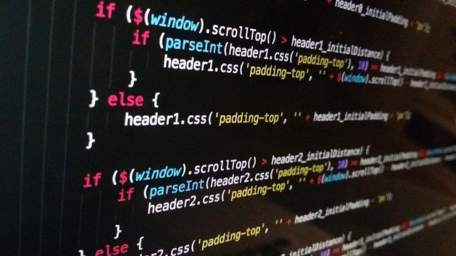 lines of JavaScript code on a black background