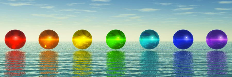 Illustration of chakras floating over the water and how we use chakras in Quantum Touch