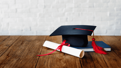 Graduate hat and diploma lay on desk at higher education place that uses top 5 kpis for higher education #business