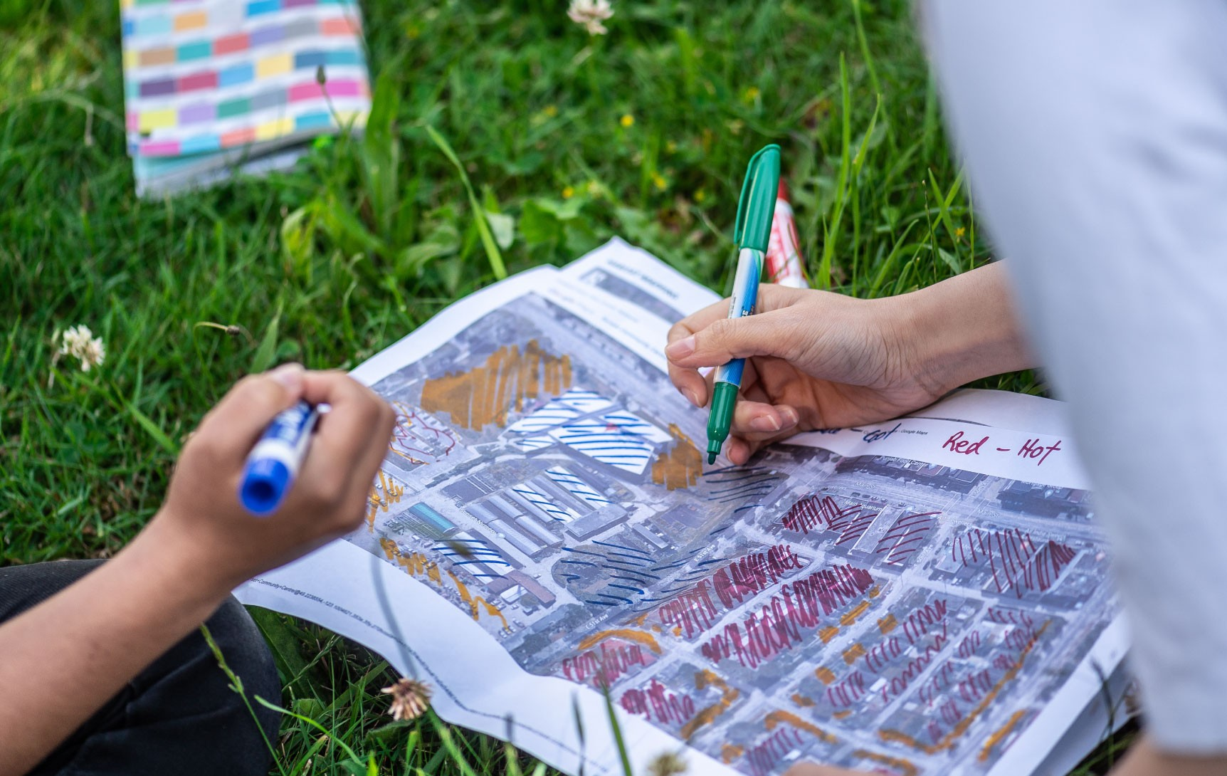 Two people look at a map of the neighbourhood to determine where it is vulnerable to climate change dangers