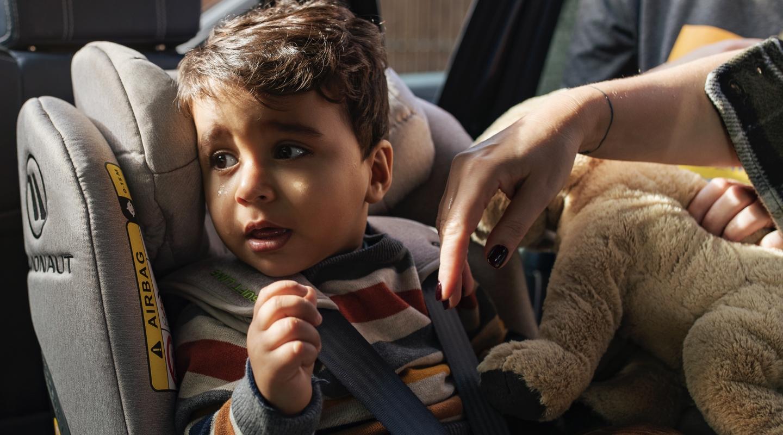 A child in an Avionaut car seat