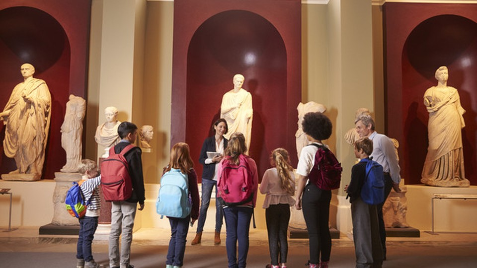 A group mixed of adult and children visiting a museum