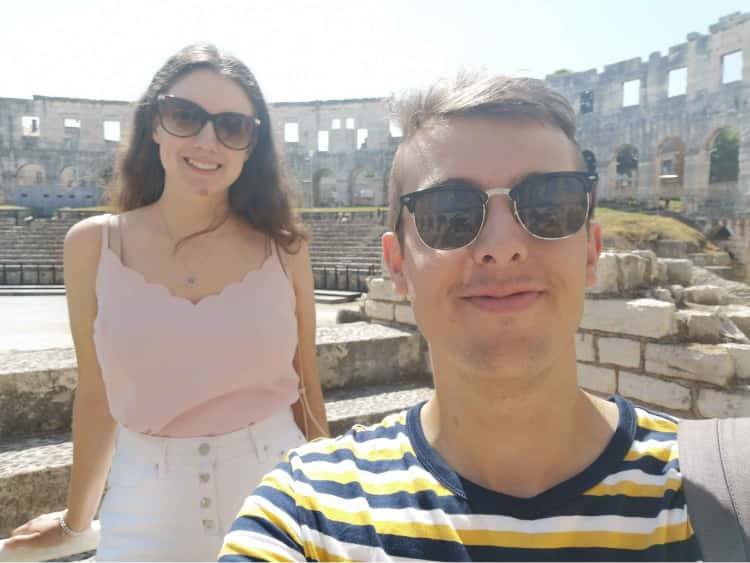 Myself and Naomi, wearing our sunglasses and stood around the side of the colosseum in Pula, Croatia.
