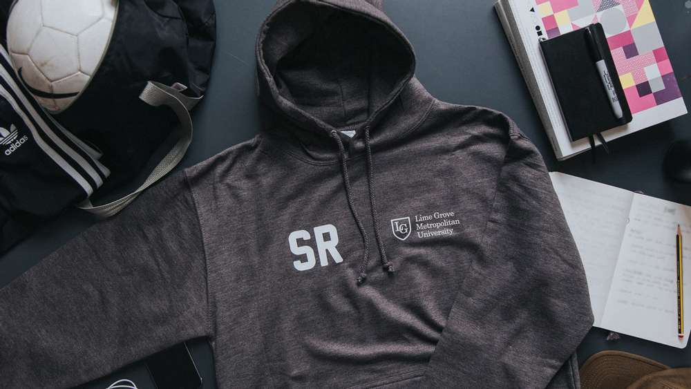A charcoal grey leavers hoodie with the school logo and individual intials printed on the front