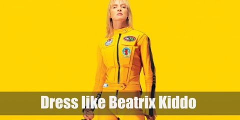 Beatrix Kiddo wears a bright yellow with black stripe long-sleeved shirt with matching sweatpants, a yellow motorcycle jacket, and a pair of yellow sneakers.