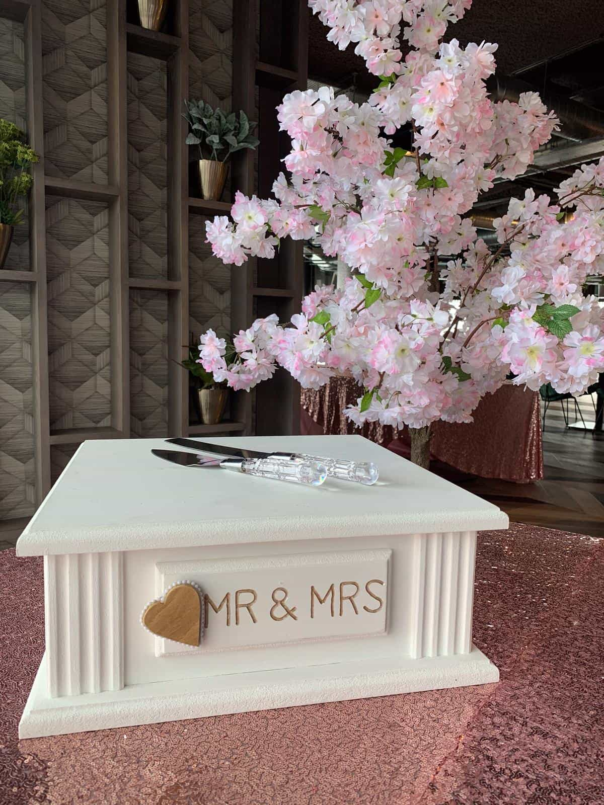 Wedding cakestand with pink rose blossom tree in background
