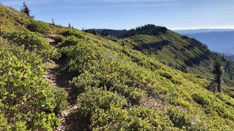 The trail follows a ridge