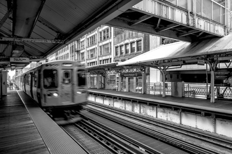 The chicago l train coming into the station
