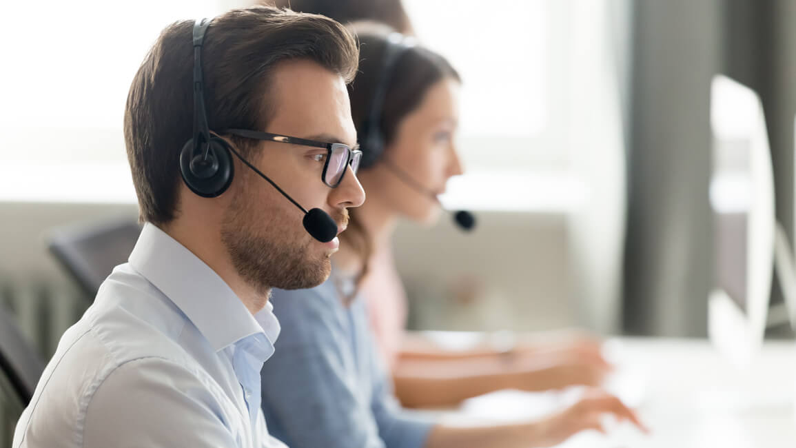 man sitting at work with headset on