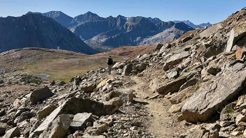 A hiker descends from Pinchot Pass