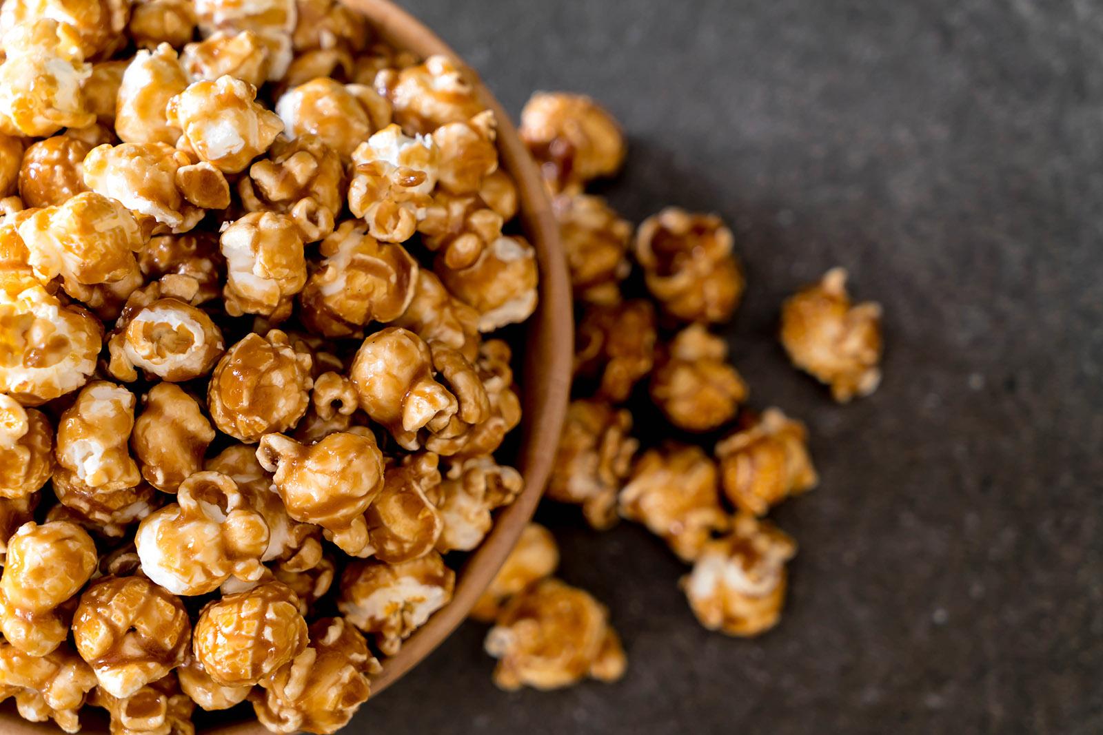 caramel popcorn in a wooden bowl