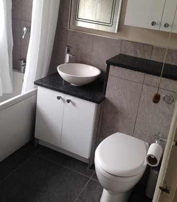 A new bathroom suite installed with floor to ceiling tiling