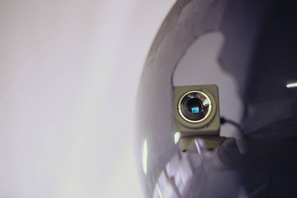 Close up of a security camera that looks directly at you