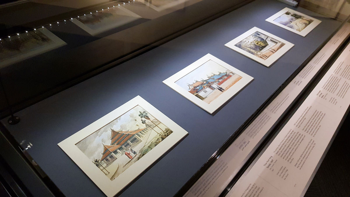 Photo close-up of various watercolour sketches featuring Singapore landmarks in 1800s.