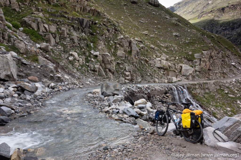 Ready to ride through a stream flowing on the road. Dry bags (waterproof Ortliebs) but wet shoes.