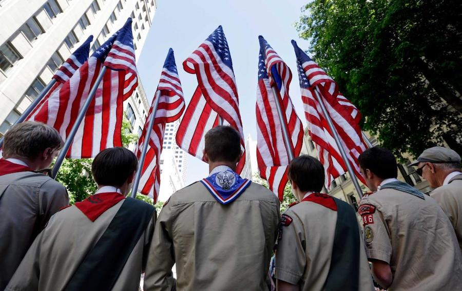 Scouts in front of American flags