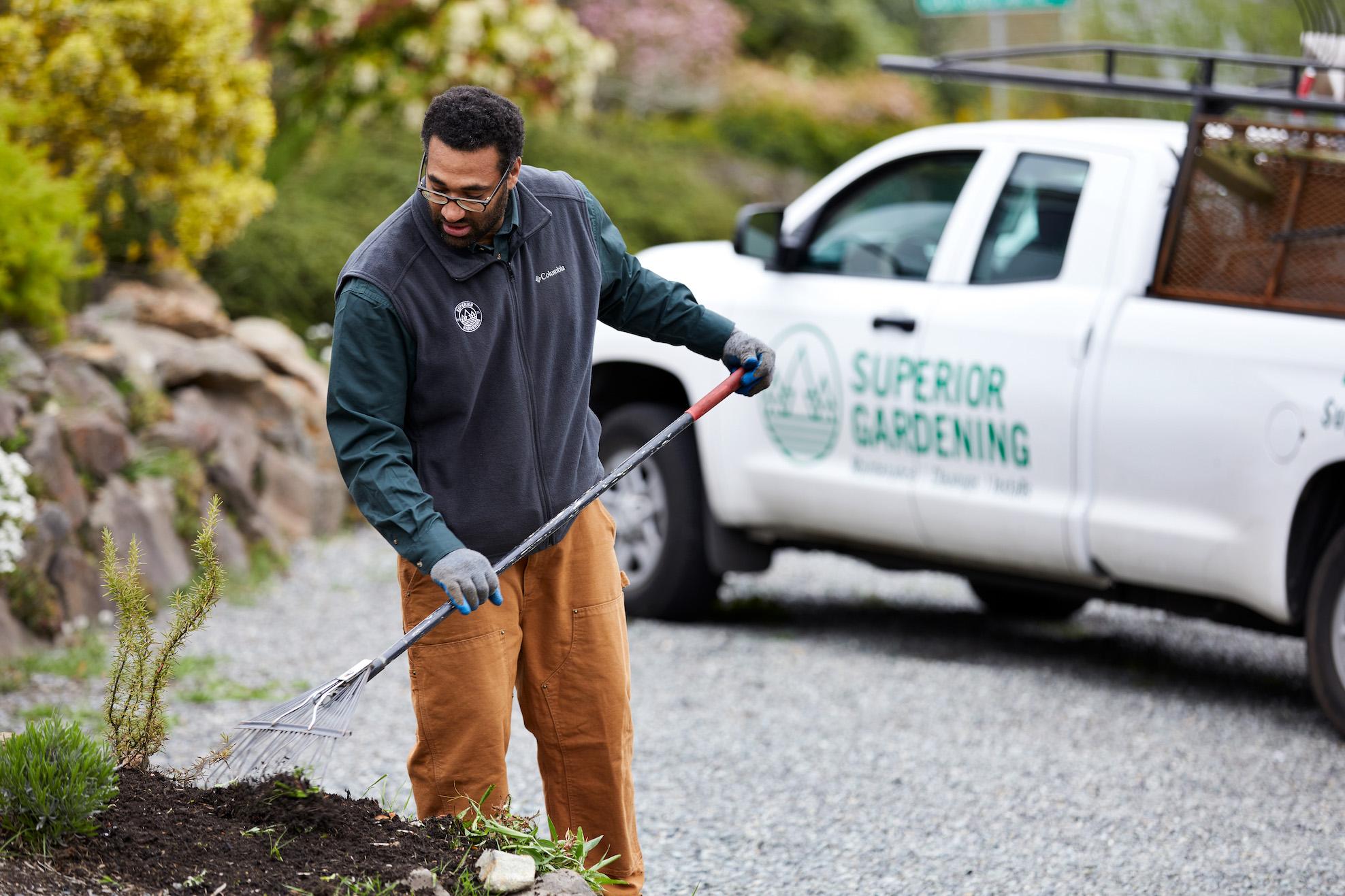Superior Gardening Landscaper Blowing Leaves for Superior Gardening Seattle.jpg