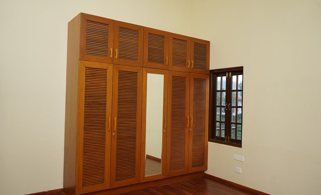 The fixed cupboards are done with teak wood