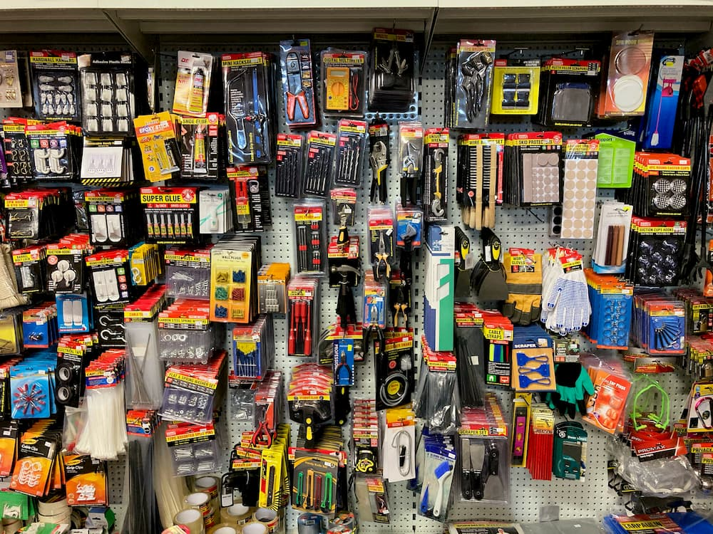 Tools, glue, picture frame hooks, home and vehicle maintenance items, and other hardware.