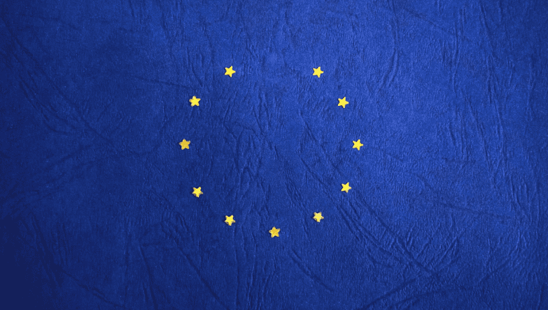 A blue background with eleven gold stars in a circle with a space missing representing the European Union flag to represent the UK leaving the EU for a blog giving business owners advice on how to cope with Brexit.