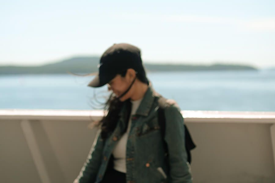 A blurry photo of me standing on the ferry deck.