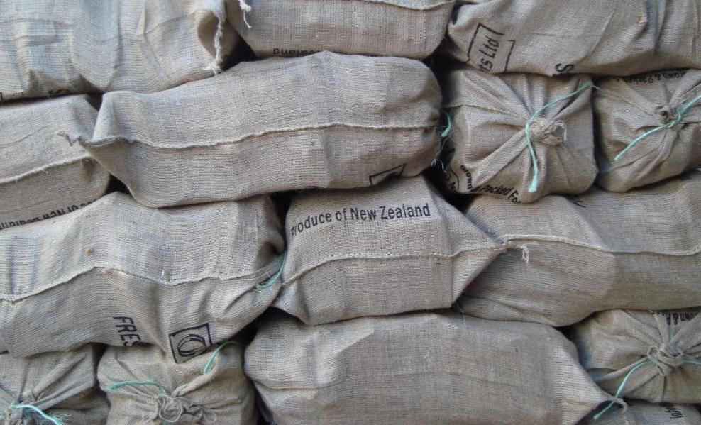 Stacked dry bags of hardwood