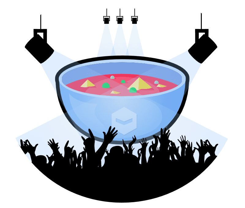 A giant bowl of soup on a well lit stage with the salutes of a crowd in front.